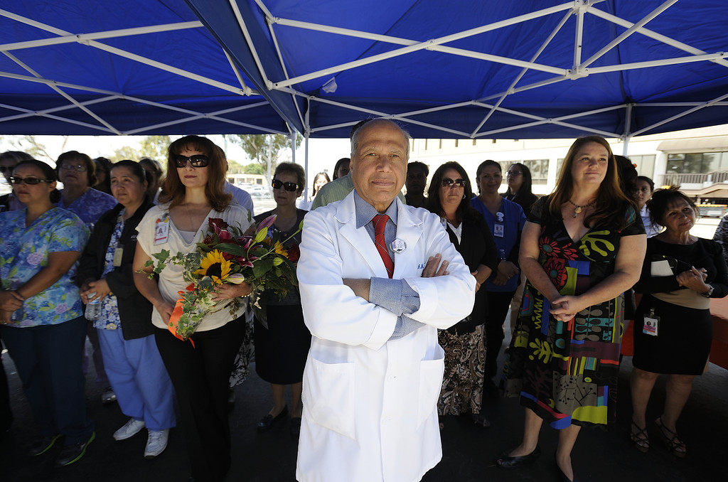 . LONG BEACH, CALIF. USA -- MemorialCare employees, including oncologist Dr. Alam Nisar M. Syed, watch hospital officials get the keys to the Todd Cancer Institute at Long Beach Memorial Medical Center on April 22, 2013. The new $31 million Todd Cancer Pavilion is scheduled to be unveiled to the public on Saturday, June 29 and open to patients on Monday, July 15. Photo by Jeff Gritchen / Los Angeles Newspaper Group