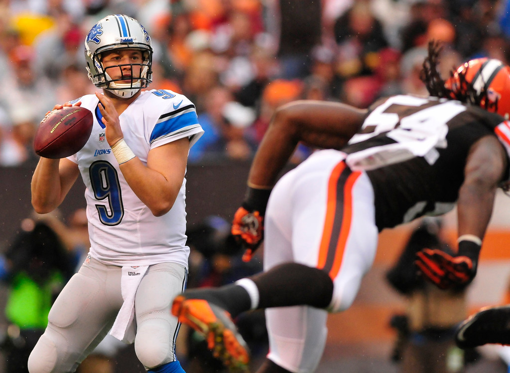 . Sam Greene/The Morning Journal Lions quarterback Matthew Stafford (9) drops back for a pass during the second quarter of the NFL week six game between the Cleveland Browns and Detroit Lions at FirstEnergy Stadium in Cleveland, Ohio, on Sunday, Oct. 13, 2013. Stafford threw 25-for-43 with 4 touchdowns in Detroit\'s 31-17 victory, improving to 4-2 on the season.