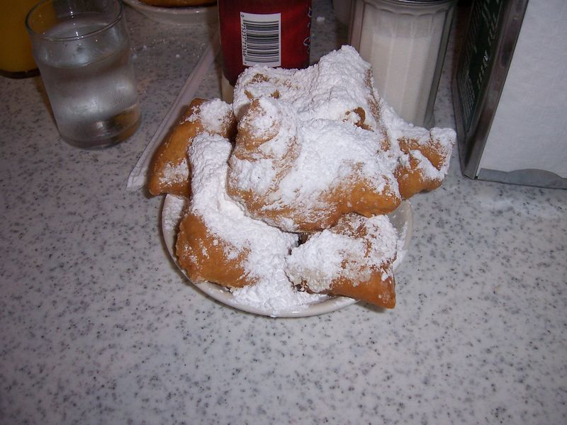 They're called beignets, they're donuts that are just like funnel cake.  Oh my gosh......YUMMMY!!!!