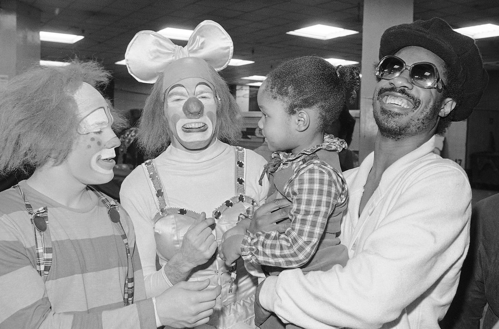 . Stevie Wonder, right, with daughter Ayesha Clowning with clowns backstage at the Ringling Bros., Barnum & Bailey circus during the intermission on Monday, March 27, 1978 at New York?s Madison square garden. (AP Photo/Richard Drew)