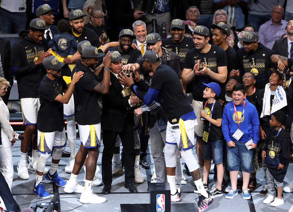 . The Golden State Warriors celebrate after the Warriors defeated the Cleveland Cavaliers 108-85 in Game 4 of basketball\'s NBA Finals to win the NBA championship, Friday, June 8, 2018, in Cleveland. (AP Photo/Carlos Osorio)