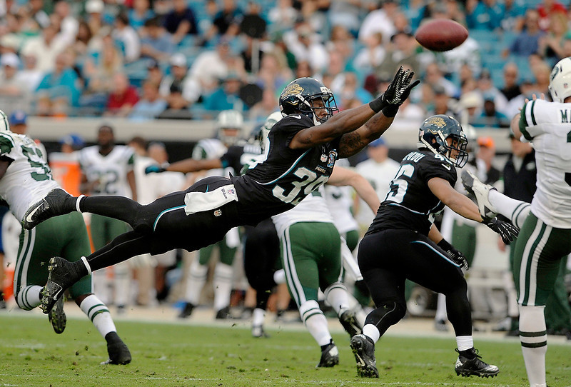 . Jacksonville Jaguars running back Richard Murphy (39) attempts to block a punt by New York Jets punter Robert Malone (3) during the second half of an NFL football game, Sunday, Dec. 9, 2012, in Jacksonville, Fla. The Jets beat the Jaguars 17-10. (AP Photo/Stephen Morton)