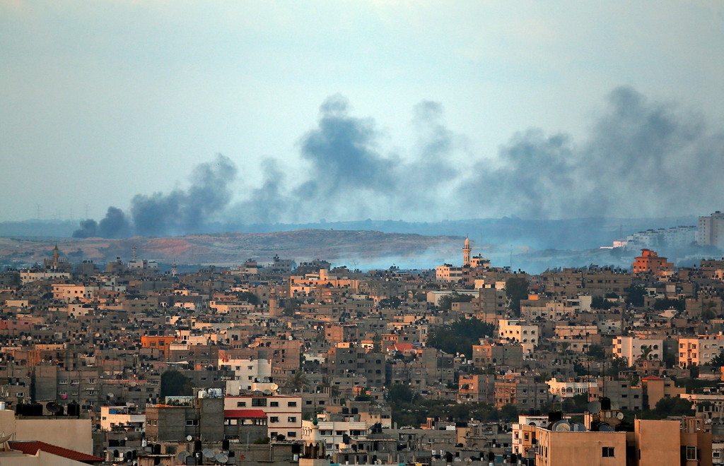 . Smoke rises after an Israeli missile strike hit the northern Gaza Strip, Thursday, July 17, 2014. Palestinian health officials say that in total, over 200 Palestinians have been killed. On the Israeli side, one man has been killed since July 8.  (AP Photo/Lefteris Pitarakis)