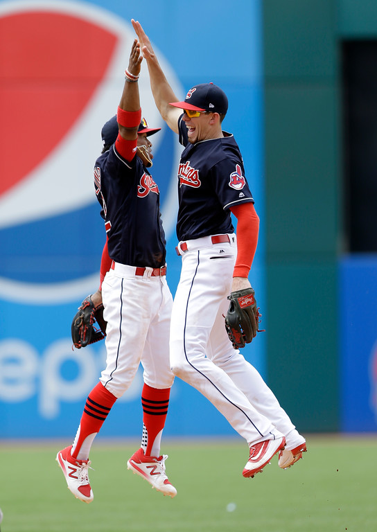 . Cleveland Indians\' Francisco Lindor, left, and Bradley Zimmer celebrate after the Indians defeated the Texas Rangers 5-1 in a baseball game, Thursday, June 29, 2017, in Cleveland. (AP Photo/Tony Dejak)