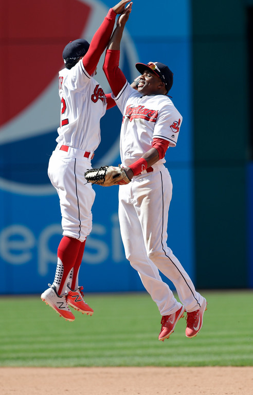 . Cleveland Indians\' Greg Allen, right, celebrates with Francisco Lindor after the Indians defeated the Kansas City Royals 3-1 in a baseball game, Wednesday, Sept. 5, 2018, in Cleveland. (AP Photo/Tony Dejak)
