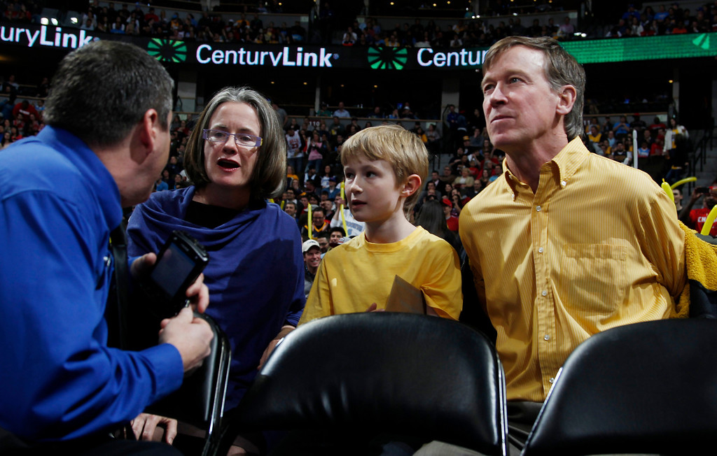 . From left, Helen Thorpe joins her son, Teddy, and husband, Colorado Gov. John Hickenlooper, in courtside seats to watch the Chicago Bulls face the Denver Nuggets in the first quarter of an NBA basketball game in Denver on Thursday, Feb. 7, 2013. (AP Photo/David Zalubowski)