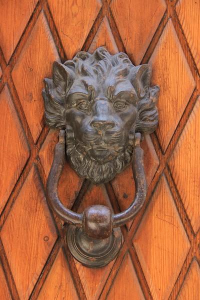 Lion-themed door knocker in Siena.