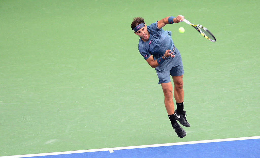 . Spanish tennis player Rafael Nadal serves to Serbia\'s Novak Djokovic during the 2013 US Open men\'s final at the USTA Billie Jean King National Tennis Center in New York on September 9, 2013.    EMMANUEL DUNAND/AFP/Getty Images