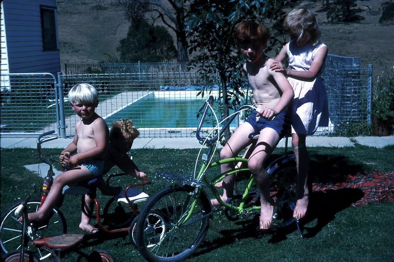 1972-12-6 (20) Andrew 3 yrs 4 mths, Allen 1 yr 7 mths, David 9 yrs & Susan  7 yrs 5 mths riding by pool.jpg