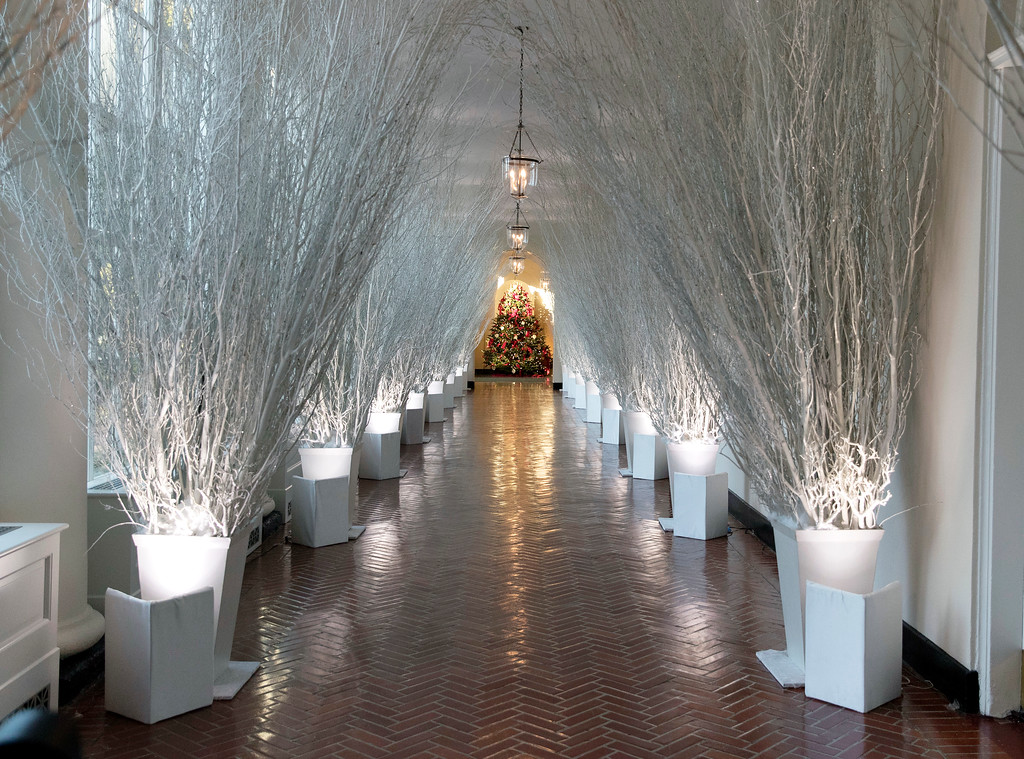 . The East Colonnade is decorated with white branches that lead to a Christmas tree in the the East Garden Room during a media preview of the 2017 holiday decorations at the White House in Washington, Monday, Nov. 27, 2017. (AP Photo/Carolyn Kaster)