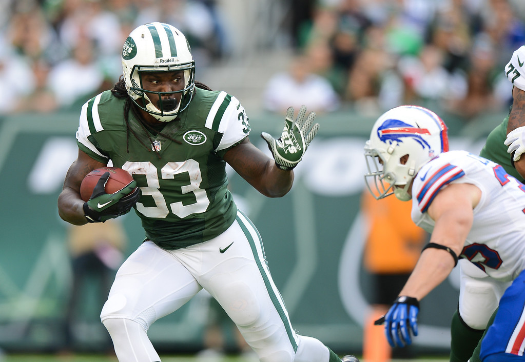 . Running back Chris Ivory #33 of the New York Jets carries the ball in the 1st half of the Jets game against the Buffalo Bills at MetLife Stadium on September 22, 2013 in East Rutherford, New Jersey. (Photo by Ron Antonelli/Getty Images)
