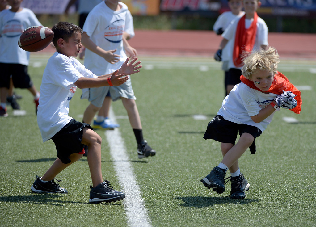 . Football campers get in a game during the afternoon at Littleton H.S. Demaryius Thomas and Eric Decker team up with ProCamps for their football camp held at Littleton High School July 11, 2013. (Photo By John Leyba/The Denver Post)