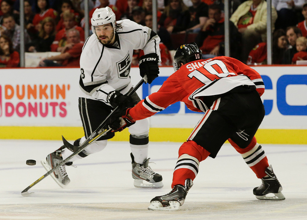 . Los Angeles Kings defenseman Drew Doughty (8) battles for the puck against Chicago Blackhawks center Patrick Sharp (10) during the first period of Game 2 of the NHL hockey Stanley Cup Western Conference finals, Sunday, June 2, 2013, in Chicago. (AP Photo/Nam Y. Huh)