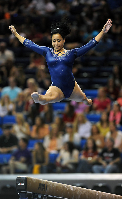 . UCLA\'s Sophina DeJesus performs on the balance beam at the NCAA Women\'s Gymnastics Championship Team Finals at Pauley Pavilion, Saturday, April 20, 2013. (Michael Owen Baker/Staff Photographer)