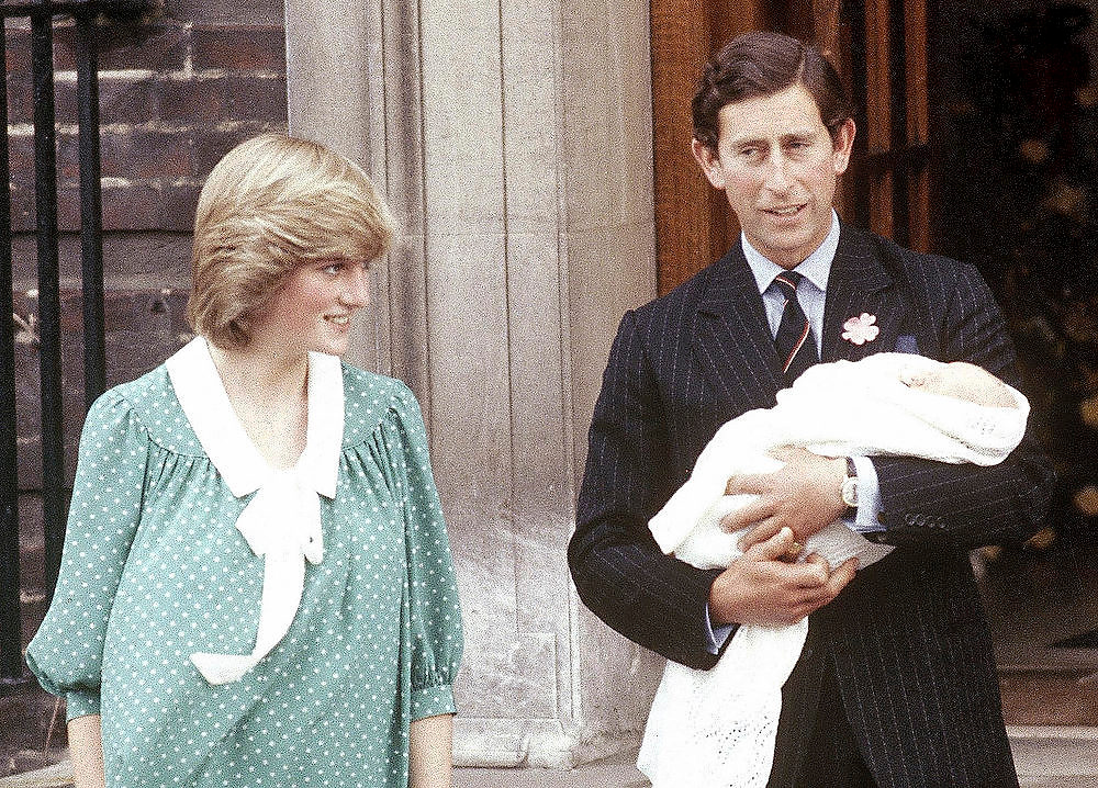 Description of . In this June 22, 1982 file photo Britain's Prince Charles, Prince of Wales, with his wife Princess Diana taking their newborn son Prince William, as they left St. Mary's Hospital, Paddington, London. William, the Duke and and Kate, Duchess of Cambridge are very pleased to announce that the Duchess of Cambridge is expecting a baby, St James's Palace officially announced Monday Dec. 3, 2012.  (AP Photo/John Redman)