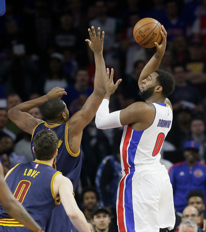 . Detroit Pistons center Andre Drummond (0) shoots over Cleveland Cavaliers center Tristan Thompson during the first half in Game 4 of a first-round NBA basketball playoff series, Sunday, April 24, 2016 in Auburn Hills, Mich. (AP Photo/Carlos Osorio)