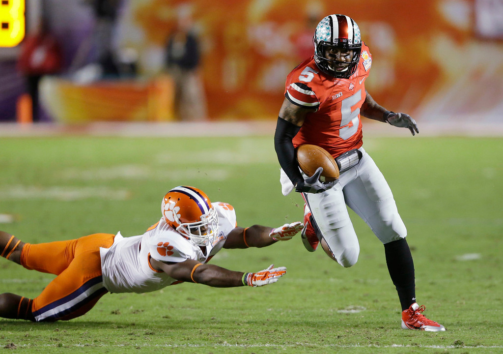 . Ohio State quarterback Braxton Miller (5) runs past Clemson safety Robert Smith on his way to a touchdown during the first half of the Orange Bowl NCAA college football game, Friday, Jan. 3, 2014, in Miami Gardens, Fla. (AP Photo/Wilfredo Lee)