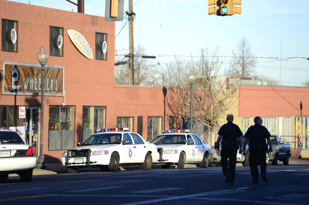 . Police secure the area near 39th and Pecos where a police officer was injured during what witnesses described as a red Dodge truck wrecking into a tree and a man exiting the truck who began shooting and fled on foot on Wednesday, January, 16, 2013. AAron Ontiveroz/The Denver Post