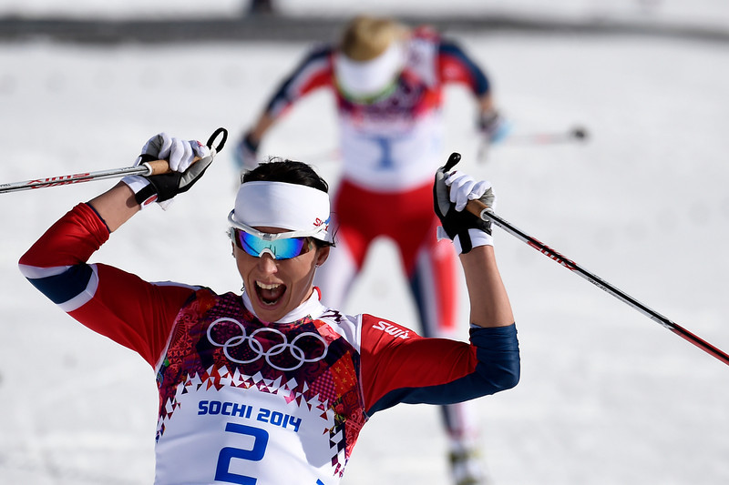 . Gold medalist Norway\'s Marit Bjoergen reacts as she crosses the finish line in the Women\'s Cross-Country Skiing 30km Mass Start Free at the Laura Cross-Country Ski and Biathlon Center during the Sochi Winter Olympics on February 22, 2014, in Rosa Khutor, near Sochi.  (ODD ANDERSEN/AFP/Getty Images)