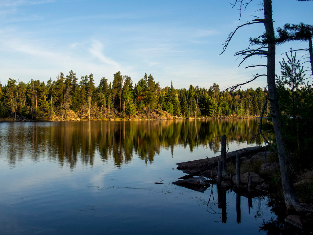 . Trees along Little Bass Lake reflect in the water on Sept. 23, 2013. (Pioneer Press: Andy Rathbun)