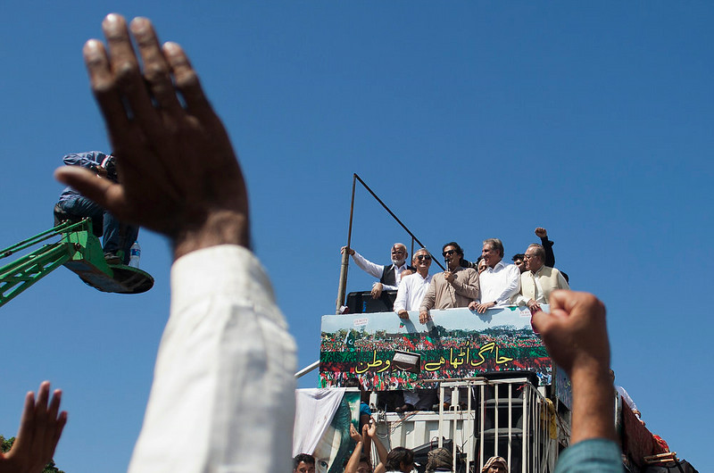. Pakistan\'s former cricket celebrity Imran Khan addresses his supporters in Islamabad, Monday, Sept. 1, 2014. Anti-government protesters and Pakistani police have clashed once again as the demonstrators pushed into a sprawling government complex in the country\'s capital in an effort to try to reach the prime minister\'s official residence. (AP Photo/B.K. Bangash)