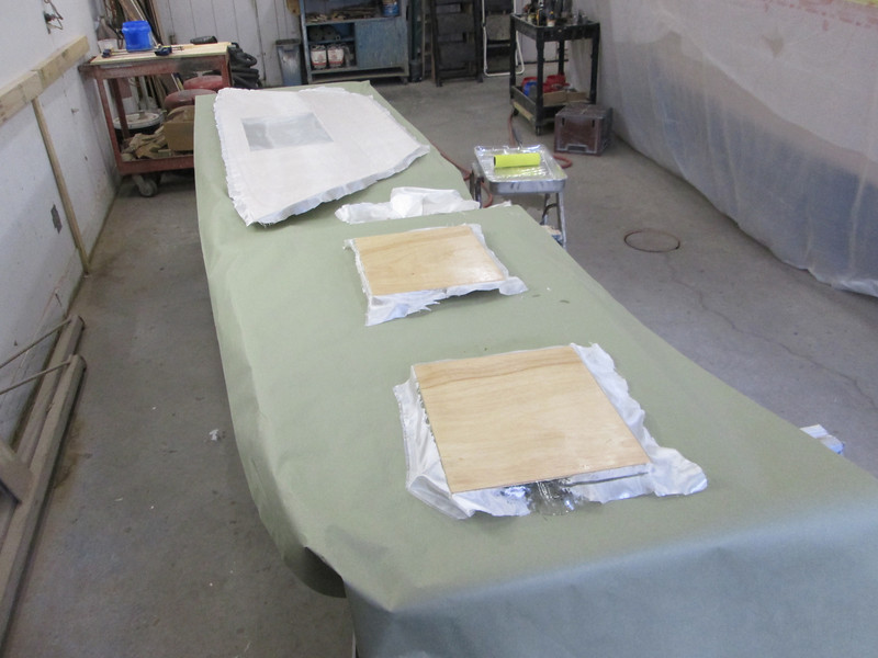 Glass cloth ready to be epoxied to the storage bulkhead and the doors.