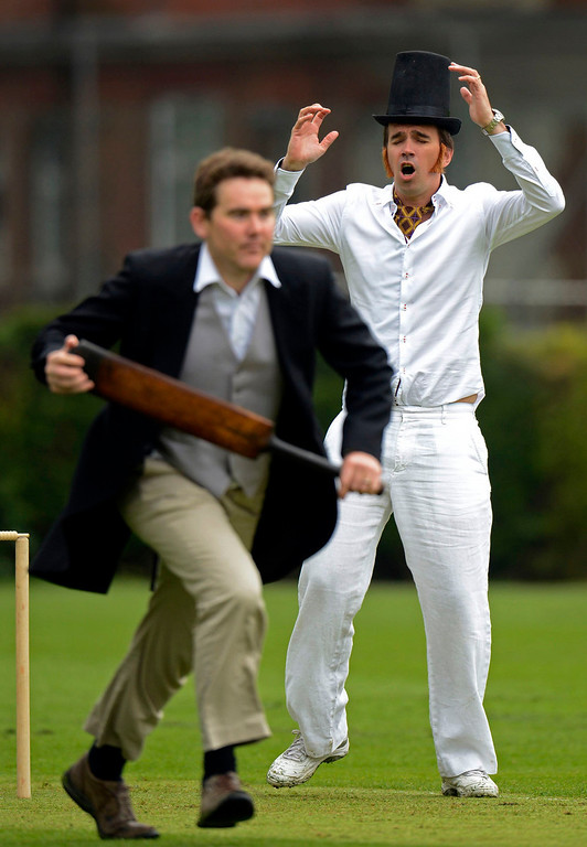 . Andrew Miller (L) runs as author Peter Frankopan reacts during a Victorian Cricket match to commemorate the 150th anniversary of Wisden Cricketers\' Almanack at Vincent Square in London May 29, 2013. REUTERS/Philip Brown