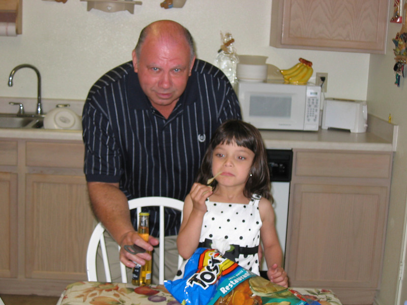 Pop and Lexy who was waiting for the picture taking to stop so she could eat her chip but barely made it.