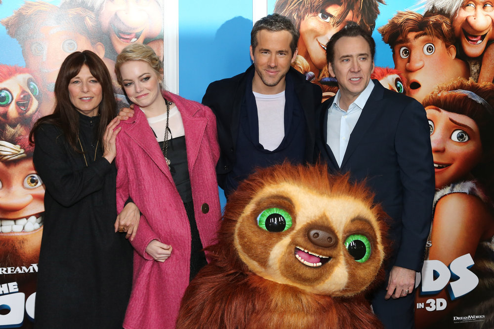 """. (L-R) Actors Christine Keener, Emma Stone, Ryan Reynolds and Nicolas Cage attend \""""The Croods\"""" premiere at AMC Loews Lincoln Square 13 theater on March 10, 2013 in New York City.  (Photo by Neilson Barnard/Getty Images)"""