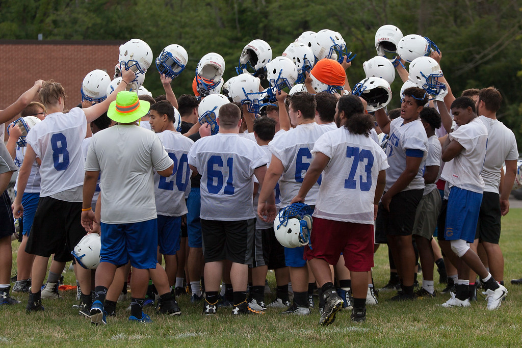 . Jen Forbus - The Morning Journal<br> The Clearview Clippers come together in a huddle during Clearview\'s first football practice on July 30.
