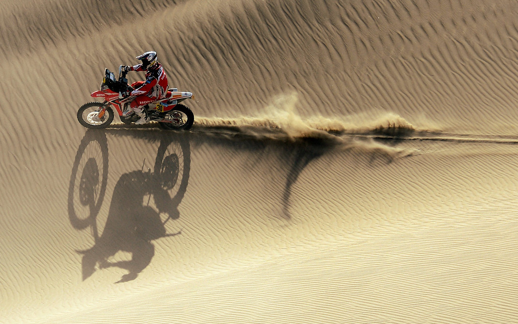 . Honda\'s biker Javier Pizzolito of Argentina competes during the Stage 2 of the Dakar 2013 in Pisco, Peru, on January 6, 2013. The rally will take place in Peru, Argentina and Chile from January 5 to 20. FRANCK FIFE/AFP/Getty Images