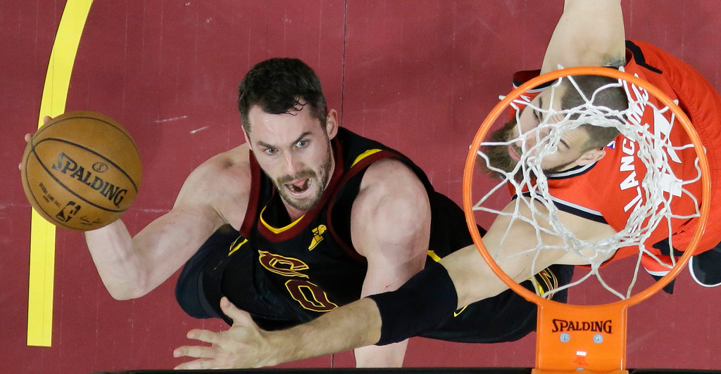 . Cleveland Cavaliers\' Kevin Love shoots against Toronto Raptors\' Jonas Valanciunas in the first half of Game 4 of an NBA basketball second-round playoff series, Monday, May 7, 2018, in Cleveland. (AP Photo/Tony Dejak)