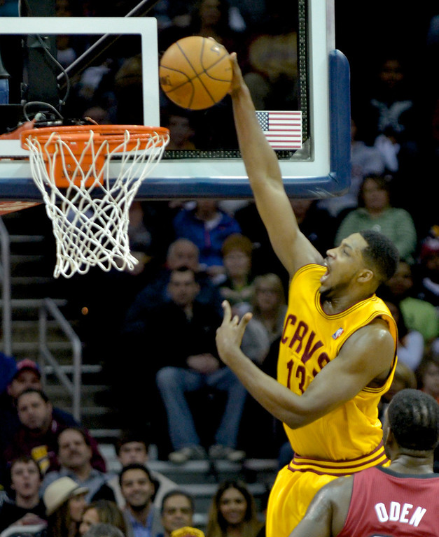 . Jeff Forman/JForman@News-Herald.com Tristan Thompson dunks in the first half of the Cavaliers\' 100-96 loss to the Heat March 18 at Quicken Loans Arena.