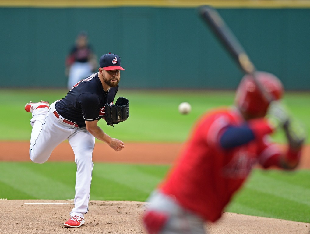 . Cleveland Indians starting pitcher Corey Kluber watches a throw during the first inning of a baseball game against the Los Angeles Angels, Thursday, Aug. 11, 2016, in Cleveland. (AP Photo/David Dermer)