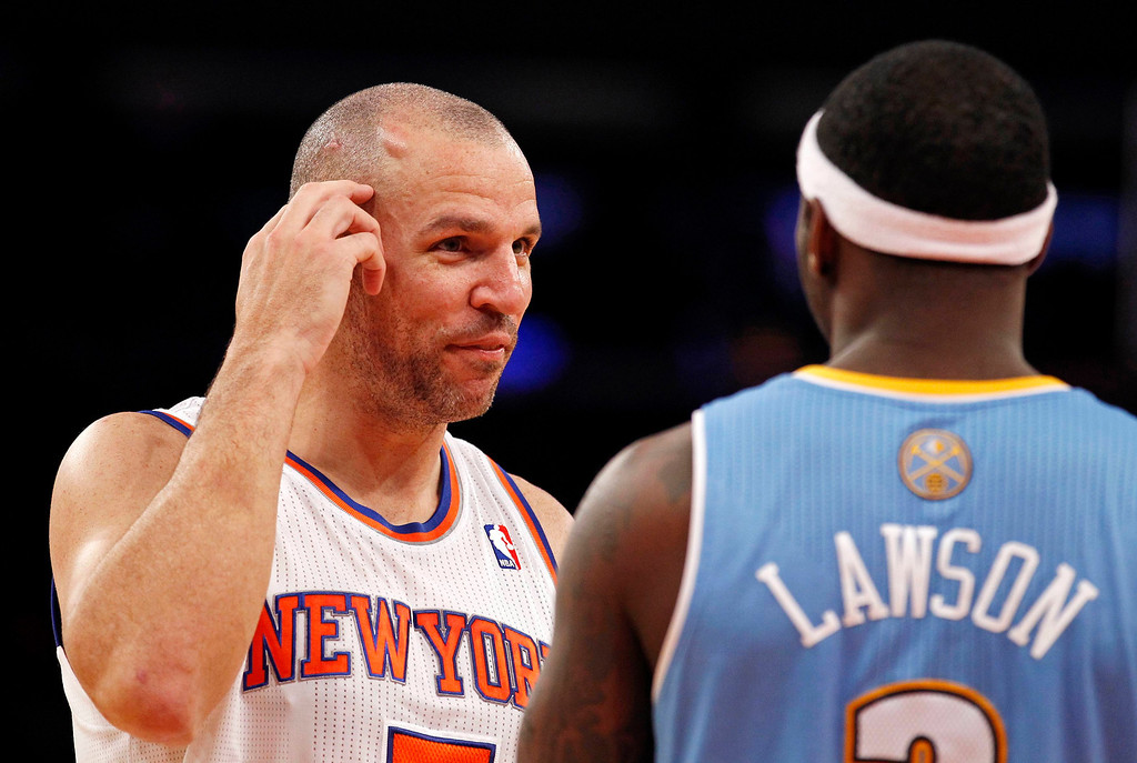 . New York Knicks point guard Jason Kidd points to a bump on his head to Denver Nuggets point guard Ty Lawson who caused the bump with a hard foul earlier in the game at the start of the third quarter of their NBA basketball game at Madison Square Garden in New York, December 9, 2012.  REUTERS/Adam Hunger (UNITED STATES - Tags: SPORT BASKETBALL TPX IMAGES OF THE DAY)