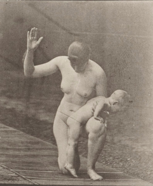Nude woman spanking a child