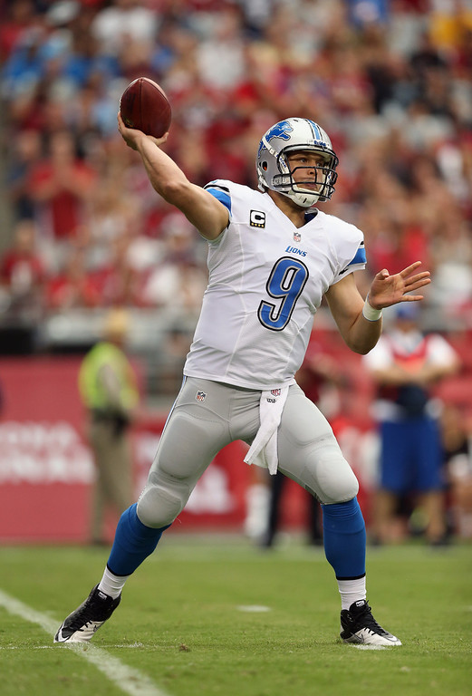 . Quarterback Matthew Stafford #9 of the Detroit Lions drops back to pass against the Arizona Cardinals in the first quarter at University of Phoenix Stadium on September 15, 2013 in Glendale, Arizona.  (Photo by Jeff Gross/Getty Images)