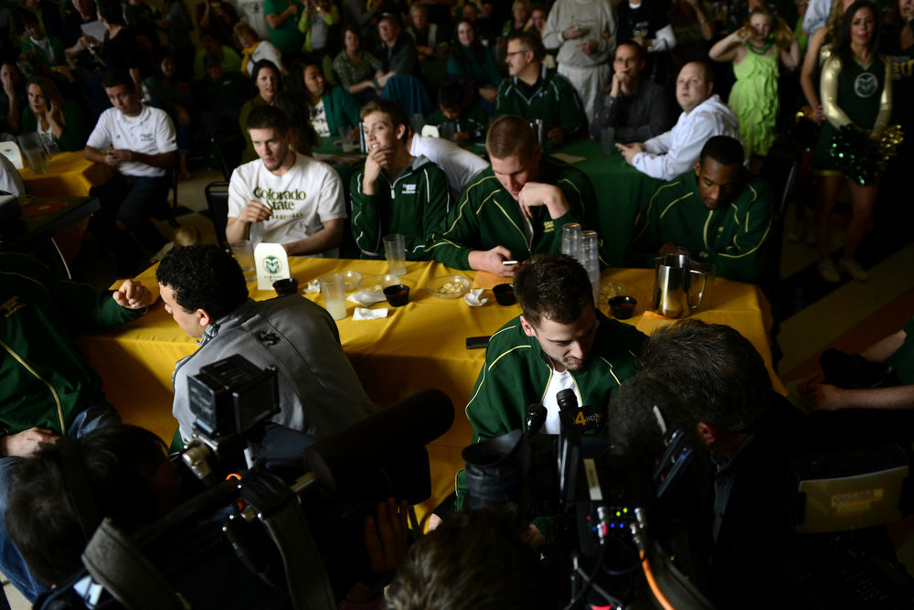 . CSU senior Wes Eikmeier conducts an interview as his teammates react to their seed during the NCAA tournament selection show. The Rams earned an eight seed and will play ninth-seeded Missouri in the second round. (Photo by AAron Ontiveroz/The Denver Post)