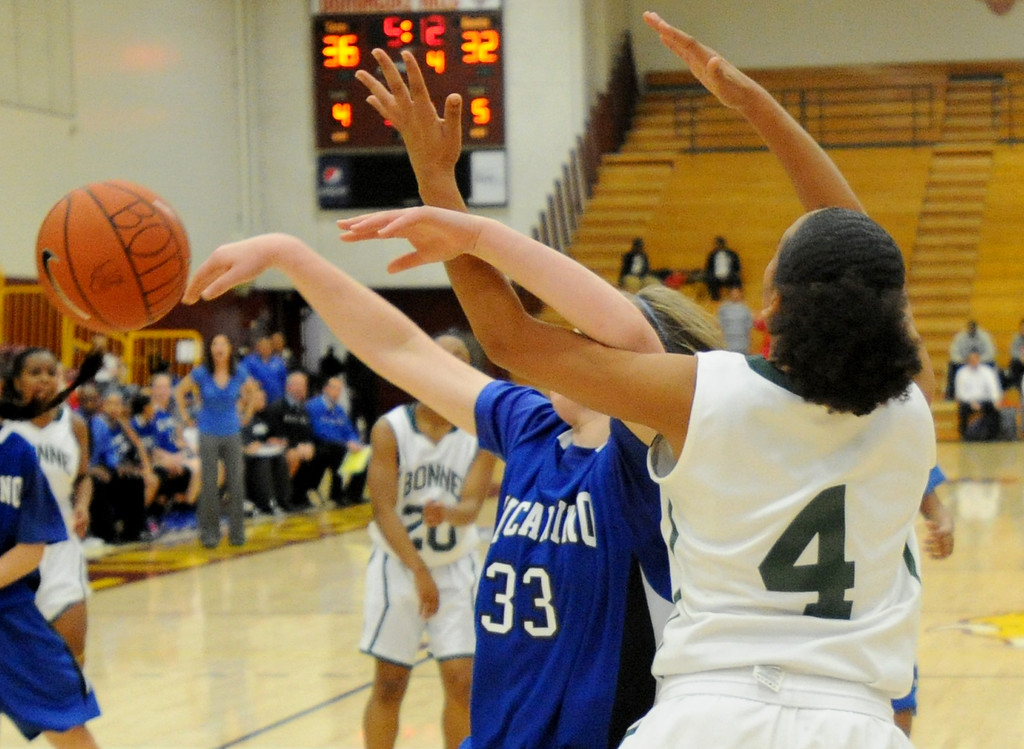 . 02-23-2012--(LANG Staff Photo by Sean Hiller)- Narbonne beat El Camino Real 47-39 in Saturday\'s L.A. City Section Division I semifinal girls basketball game. Narbonne\'sKiana Angel (4) tangles up with El Camino\'s Shaina Van Stryk (33).