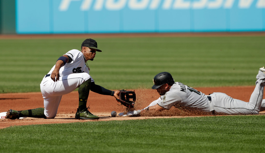 . Chicago White Sox\'s Yoan Moncada, right, slides safely into second base on a steal as Cleveland Indians\' Francisco Lindor cannot hold on to the ball in the first inning of a baseball game, Monday, May 28, 2018, in Cleveland. (AP Photo/Tony Dejak)