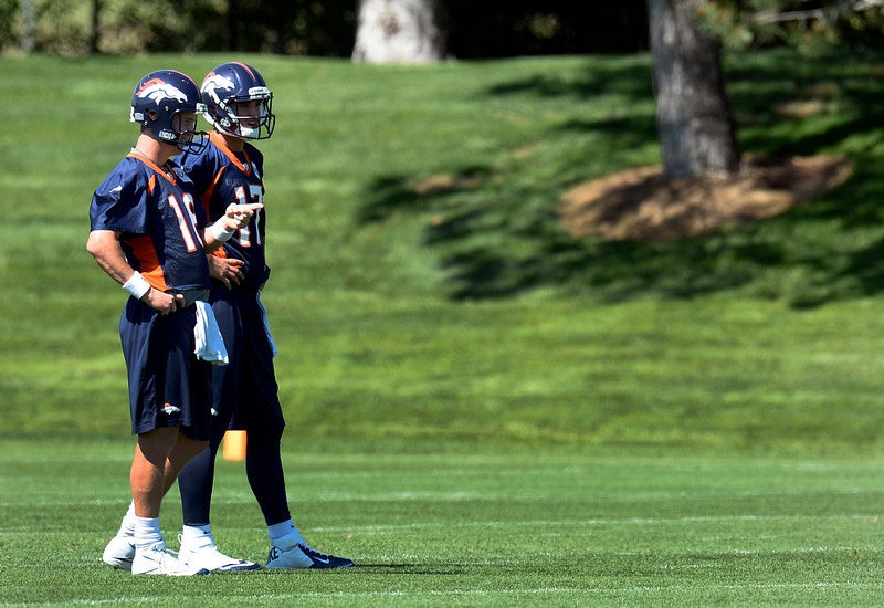 . Quarterback Peyton Manning (18) of the Denver Broncos chats with QB Brock Osweiler (17) during OTAs June 6, 2013 at Dove Valley. (Photo By John Leyba/The Denver Post)