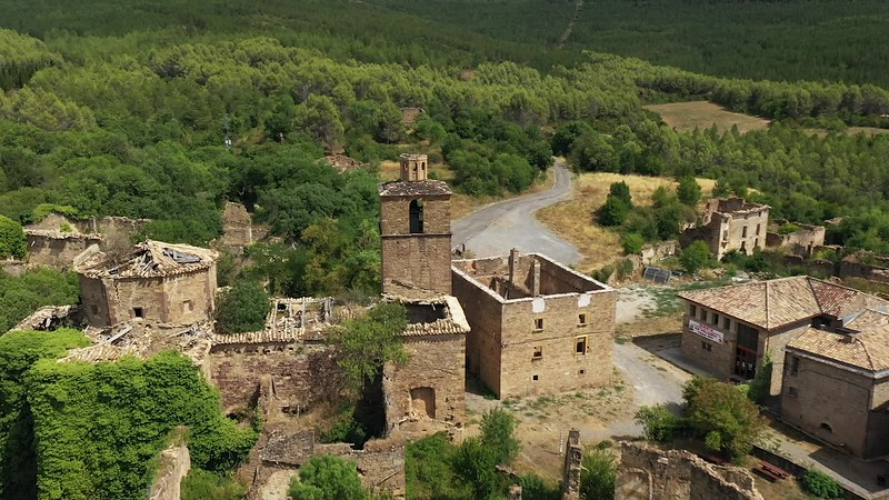 Available in 4k - Aerial drone clip showing abandoned village of Ruesta at the Embalse de Yesa (Yesa Reservoir) in the Navarra Aragon region of the Spanish Pyrenees
