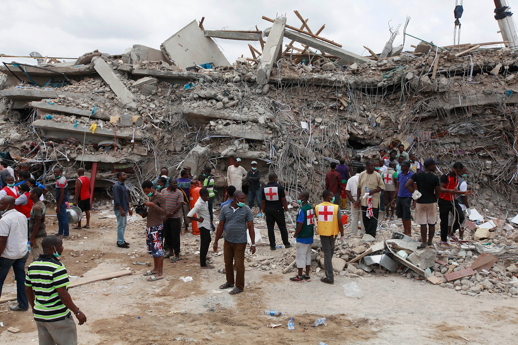 . Rescue workers search for survivors in the rubble of a collapsed building belonging to the Synagogue Church of All Nations in Lagos, Nigeria, Saturday, Sept, 13. 2014. The building was being extended, adding 2 additional floors when it collapsed. (AP Photo/Sunday Alamba)