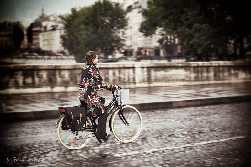 Girl on Bicycle - Pont Neuf Bridge, Paris, France - JohnBrody.com / John Brody Photography