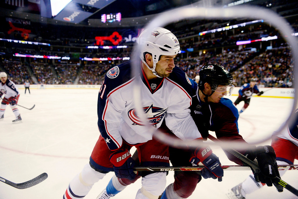 . Matt Duchene (9) of the Colorado Avalanche and Fedor Tyutin (51) of the Columbus Blue Jackets vie for position during the this period of Colorado\'s 5-3 win.   (Photo by AAron Ontiveroz/The Denver Post)