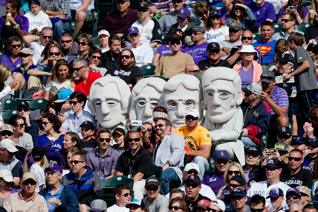 . DENVER, CO - JUNE 7:  Mascots representing the past Presidents that reside on Mount Rushmore take in a game between the Los Angeles Dodgers and Colorado Rockies at Coors Field on June 7, 2014 in Denver, Colorado. The Rockies defeated the Dodgers 5-4 in 10 innings to end their eight game losing streak. (Photo by Justin Edmonds/Getty Images)
