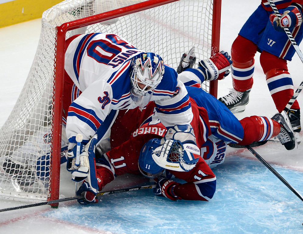 . New York Rangers goalie Henrik Lundqvist (30) is up ended by Montreal Canadiens right wing Brendan Gallagher (11) and Rangers left wing Rick Nash (61) during first period in game two of the NHL Eastern Conference final Stanley Cup playoff action Monday, May 19, 2014 in Montreal.  (AP Photo/The Canadian Press, Ryan Remiorz)