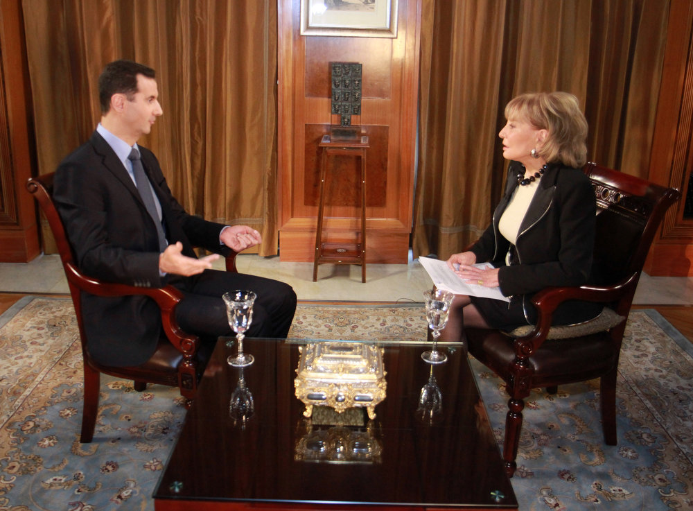 """. Syrian President Bashar Al-Assad speaks with ABC News Anchor Barbara Walters for an interview airing Wednesday, Dec. 7, 2011, on ABC. Assad denied he ordered the deadly crackdown on a nearly 9-month-old uprising in his country, claiming he is not in charge of the troops behind the assault. Speaking to Walters in a rare interview that aired Wednesday, he maintained he did not give any commands \""""to kill or be brutal.\"""" (AP Photo/ABC, Rob Wallace)"""