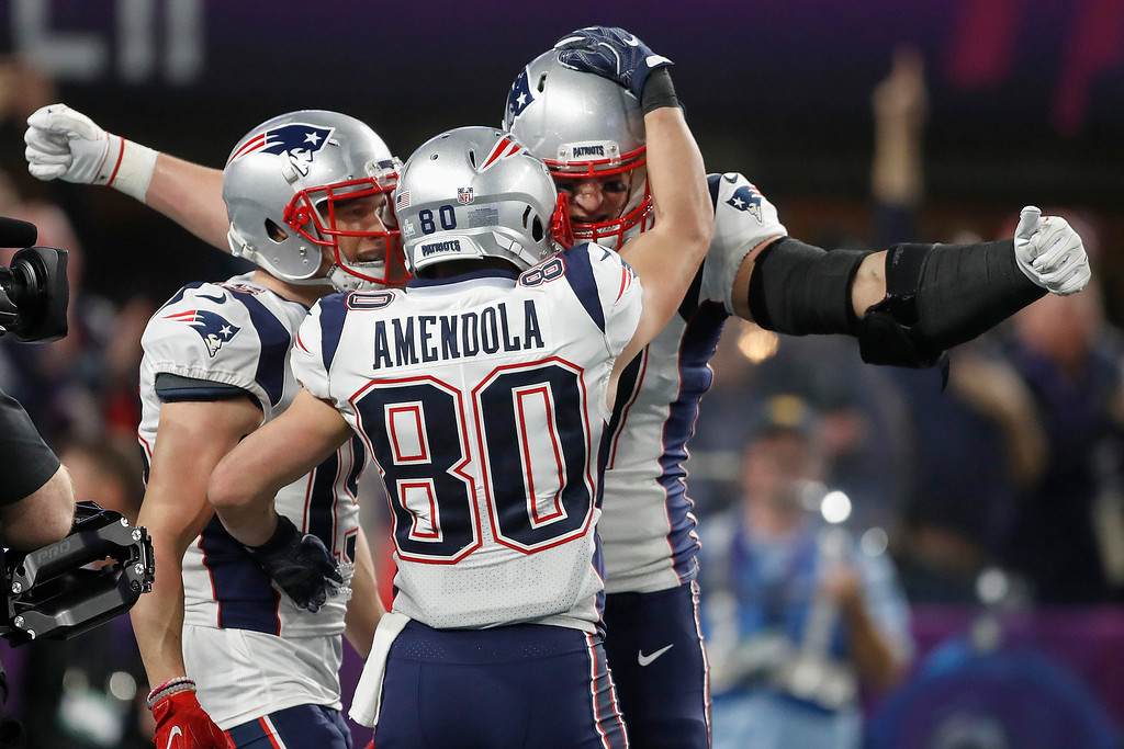. New England Patriots\' Rob Gronkowski, rear, celebrates his touchdown catch with wide receiver Danny Amendola during the second half of the NFL Super Bowl 52 football game against the Philadelphia Eagles Sunday, Feb. 4, 2018, in Minneapolis. (AP Photo/Jeff Roberson)