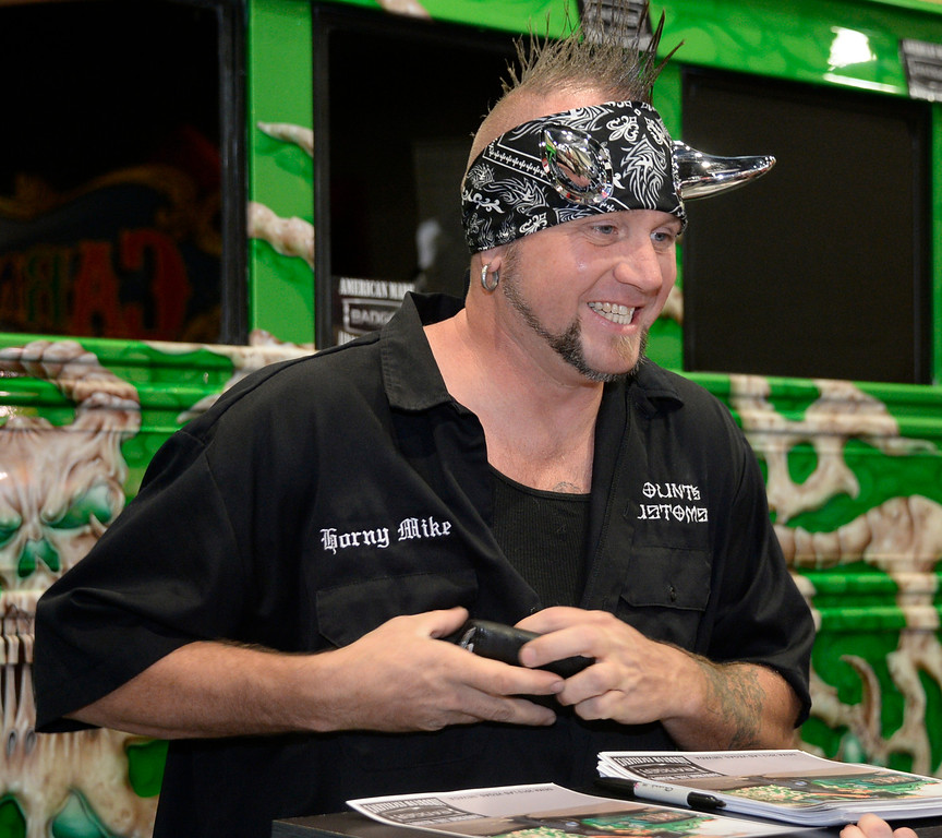 . Nov 6,2013 Las Vegas NV. USA. Airbrush artist  Horny Mike from the cable show Counting Cars, signs autographs during the second day of the 2013 SEMA auto show. Photo by Gene Blevins/LA Daily News   MIke Horny